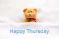 Teddy Bear Lying In The White Bed With Message  Happy Thursday Stock Photos - 77278733