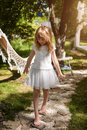 Little Girl Walking On The Stones In The Garden And Having Fun Outdoor Royalty Free Stock Image - 77307586