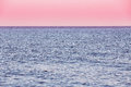 Calm Sea Ocean And Pink Sky Sunset Sunrise Background Stock Images - 77309604
