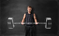 Muscled Young Man Lifting Hand Drawn Weight On The Background Of Blackboard Royalty Free Stock Photography - 77314977