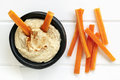 Hummus With Carrot Sticks Top View Stock Image - 77324001