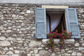 Old Window With Open Shutters With Flowers On The Window Sill On The Stone Wall. Italian Village Stock Photography - 77346022