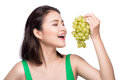 Young Beautiful Asian Woman Eating Fresh Grapes Isolated On Whit Stock Photography - 77348902