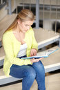 High School Student Girl Reading Book On Stairs Stock Images - 77359354