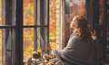 Happy Young Woman Enjoying Fresh Autumn Air At Open Window Royalty Free Stock Photo - 77367405