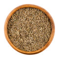Cumin Seeds In A Wooden Bowl Over White Royalty Free Stock Photography - 77393907