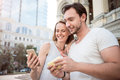 One Young Couple Using Smart Phone Stock Photos - 77395623