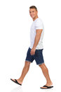 Walking Man In White T-shir And Looking At Camera. Royalty Free Stock Image - 77405536