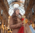 Woman With Shopping Bags In Milan Looking On Christmas Gift Royalty Free Stock Photo - 77410655