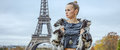 Fashion-monger In Front Of Eiffel Tower In Paris Looking Aside Stock Photography - 77410952