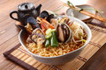 Big Bowl Of Instant Noodle With Abalone, Shrimp, Clams, Onion An Royalty Free Stock Images - 77416849