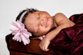 Sweet African American Baby Asleep In A Wooden Crate Stock Photography - 77420092