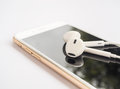 Earbuds On Top Of Smartphone Screen Isolate Royalty Free Stock Photo - 77421285
