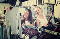 Two  Women Picking New Blouse In Fashion Shop Royalty Free Stock Image - 77450526