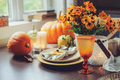 Autumn Traditional Seasonal Table Setting At Home With Pumpkins, Candles And Flowers Royalty Free Stock Image - 77471456