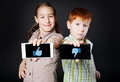 Girl And Boy, Children Show Mobile With Thumb Up Down Stock Photos - 77472703