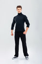 Full Length Of Strong Young Man In Black Clothes Standing Royalty Free Stock Photos - 77476618