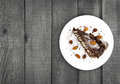 Chocolate Cake Slice With Nut On Plate On Wooden Table, Top View Stock Photos - 77500523