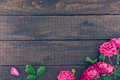 Frame Of Roses On Dark Rustic Wooden Background. Spring Flowers. Stock Photo - 77501590