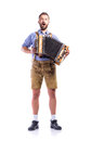 Man In Bavarian Clothes Playing Accordion And Singing. Oktoberfe Royalty Free Stock Image - 77506056