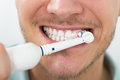 Man Teeth With Electric Toothbrush Royalty Free Stock Images - 77511159