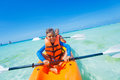 Kids Paddling In Kayak Stock Photos - 77516923