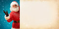 Smiling Santa Claus Holding Old Paper Banner With Space For Your Text Royalty Free Stock Photo - 77532655
