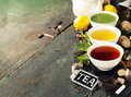 Different Kinds Of Tea In Ceramic Bowls Stock Photo - 77545030