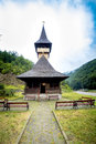 Traditional Wooden Church In The Mountains Against A Cloudy Sky Royalty Free Stock Photos - 77549728