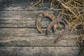 The Old Horseshoe And Straw Royalty Free Stock Images - 77552859