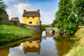 Cottage On A Moat Stock Photo - 77565300