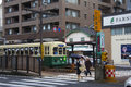 NAGASAKI, JAPAN - August 19, 2015 Cars And Vintage Tram On The R Royalty Free Stock Photo - 77574215