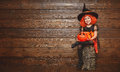 Funny Child Girl In Witch Costume  For Halloween With Pumpkin Ja Royalty Free Stock Photo - 77589925