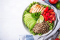Healthy Salad Bowl With Quinoa, Tomatoes, Chicken, Avocado, Lime And Mixed Greens, Lettuce, Parsley Stock Photo - 77591940