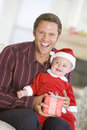 Father With Son In Santa Outfit Stock Photography - 7761082
