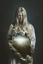 Woman Holding Magical Mirror Royalty Free Stock Photos - 77602818