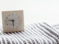 Series Of A Simple White Analog Clock On The Blanket, 10/15 Stock Photo - 77617130