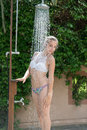 Girl Wear Bikini Standing Under The Outdoor Pool Shower Royalty Free Stock Photos - 77620818
