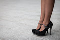Woman Wearing A Pair Of Black Classic High Heels Royalty Free Stock Photo - 77639105