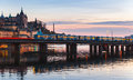 Train On Bridge Of Gamla Stan, Stockholm Royalty Free Stock Photography - 77655617