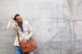 Charming Man With Leather Bag Standing Against Wall Royalty Free Stock Photo - 77679165