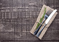 Knife And Fork Inside Kitchen Towel On Wooden Board Stock Images - 77682214