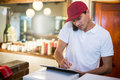 Pizza Delivery Man Taking An Order Over The Phone Royalty Free Stock Image - 77687716