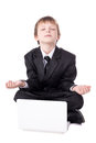 Cute Little Boy In Business Suit Sitting In Yoga Pose With Lapto Royalty Free Stock Images - 77715269