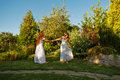 Two Sisters Whirling. Stock Photography - 77747962