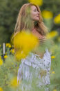 Brunette Model In A Field Of Flowers Stock Images - 77806464