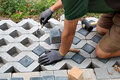 Man Laying A Garden Path With Grass Paving Blocks Stock Images - 77810884