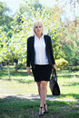 Business Woman Holding A Bag Royalty Free Stock Photo - 77820595