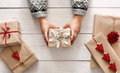 Woman S Hands Show Christmas Holiday Present With Craft Twine Royalty Free Stock Photography - 77857607