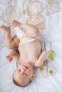 Cute Baby Lying On Bed In Bedroom Stock Photography - 77871062
